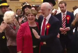 Jeremy Corbyn accidentally grabs woman's breast