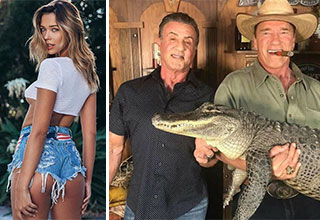 a hot babe and some dudes holding a crocodile