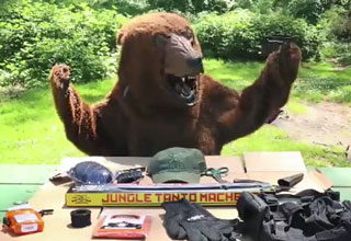 man in a bear suit with all his survival gear
