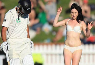cricket player with streaker and awkward pig photo