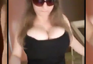 large chested woman in black top