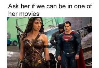 superman and batman looking at wonder woman