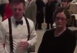 white couple stands around awkwardly at interracial marriage