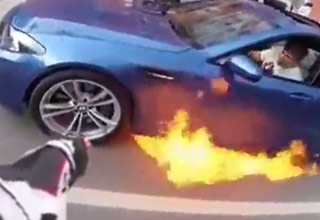 blue bmw with flames shooting out