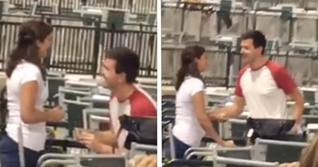 man proposing to his girlfriend at baseball game