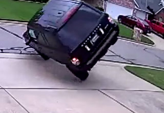 suv driving in reverse flips his car