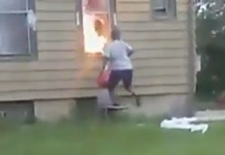 woman committing arson in milwaukee with a gas can in her hand