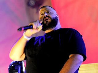dj khaled holding  a mic looking confused on stage