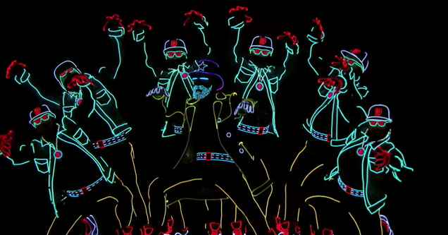 Awesome neon dance troupe lights up the stage