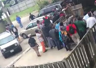 a huge crowd of people looking for drugs outside a dope house