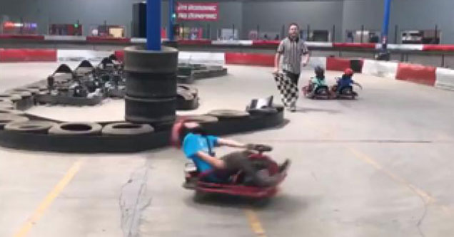 young kid on a go-cart spins out of control