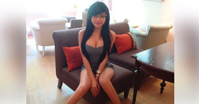 sexy woman sitting on chair in nice office