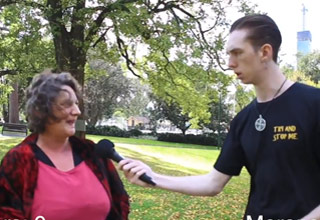 woman in pink shirt talks to man holding microphone