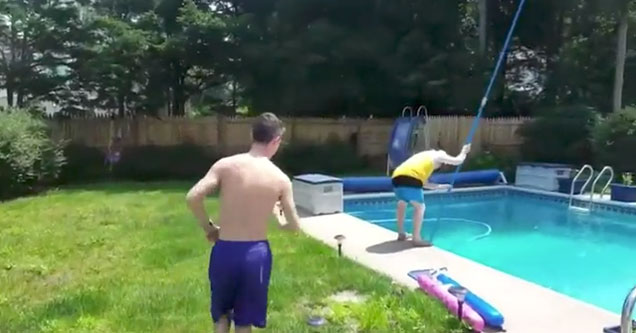 shirtless kid sneaking up on his dad cleaning the pool