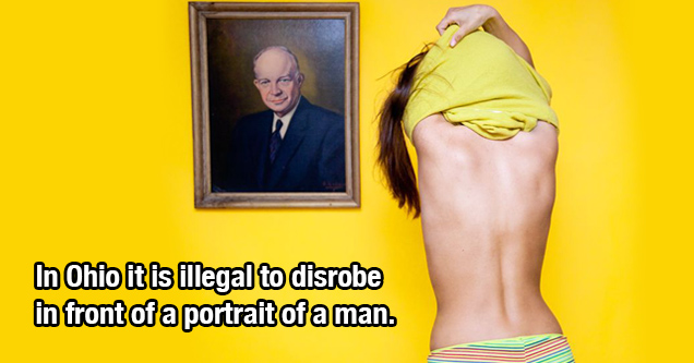 girl taking off shirt in front of man portrait