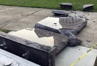 a 10 commandments statue that was knocked over by a car and smashed