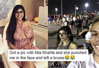mia khalifa and a fan walking down the street and her in a sun dress