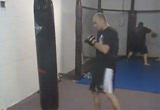 kickboxer practicing on a punching bag