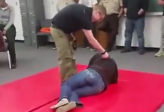 girl lying on mat gets tased and farts
