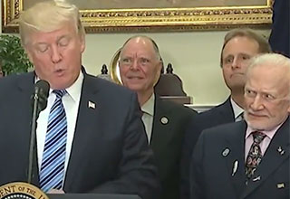 buzz aldrin giving trump funny looks