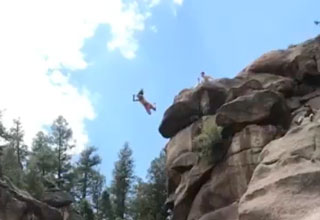 girl jumping off 83 ft cliff and belly flopping in the water