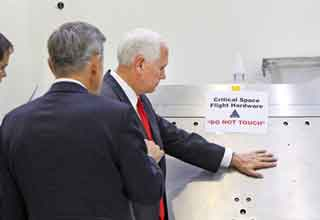 photoshop contest of mike pence touching nasa equipment