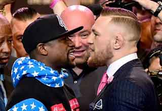 conor mcgregor and floyd mayweather standing off