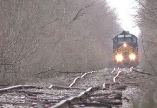 Train riding down a set of extremely crooked tracks