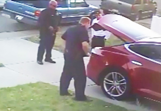 cops looking at trunk of tesla model s