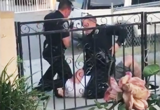 cops beating handcuffed suspect