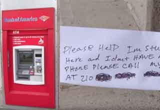 atm machine with a note from someone trapped inside