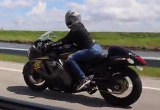 woman riding a hayabusa motorcyle