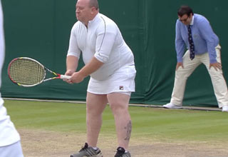 heavy set man wearing female tennis uniform at wimbledon