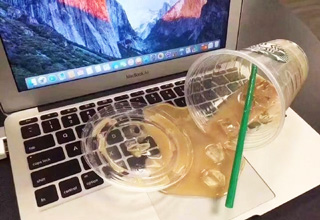 starbucks ice coffee spilled on laptop