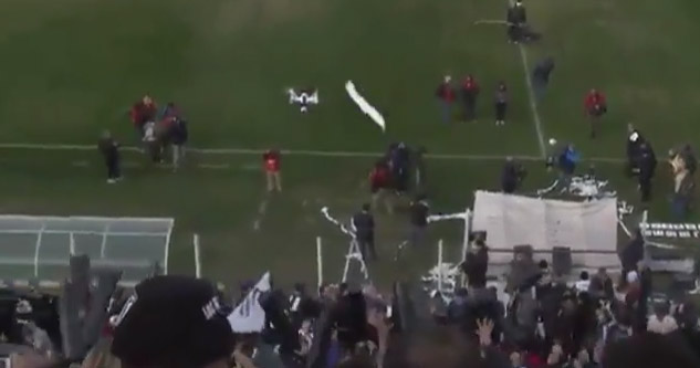 Perfectly Thrown Toilet Paper Roll Takes Out A Drone At A Soccer Game