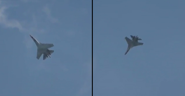 fighter jet flies upside down and floats in the sky