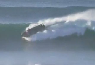Safety Boat Trapped in the Impact Zone Rides Out the Wave In Spectacular Fashion