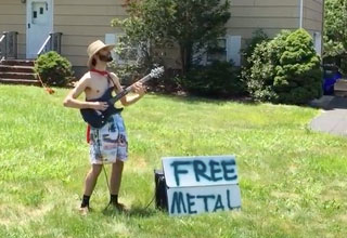 guy playing guitar in his front yard with a sign that says free metal