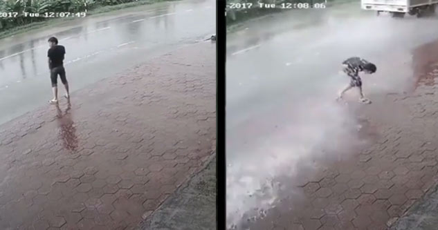 Guy Urinating In The Street Gets A Dose of Karmic Justice