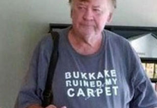 old man in shirt that says bukkake ruined my carpet