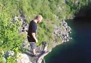 guy standing at the top of cliff