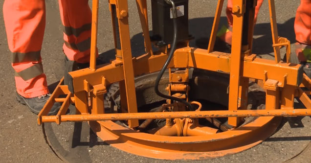 Watching A Manhole Cover Being Replaced Is Way More Interesting Than You'd Think