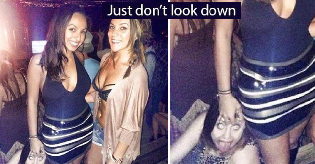 Girls at the club posing with some crazy girl crawling on the floor