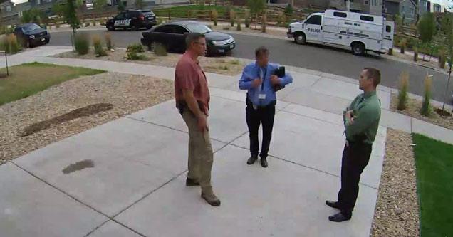 three detectives standing around talking