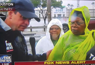 fox news reporter interviewing woman fleeing tropical storm harvey