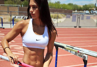 woman with ripped abs on the running track