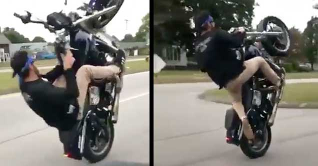 guy popping a crazy wheelie on a motorcycle
