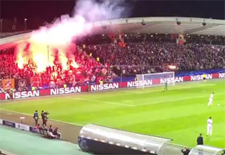 soccer ref almost hit by flare