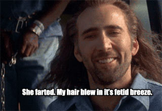 nicolas cage hair blowing in the fetid breeze