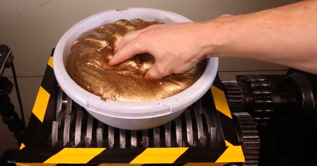 Guy Shreds A 15 Pound Blob of Gold Slime